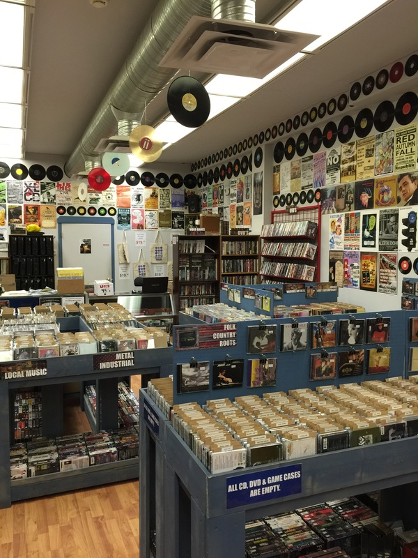 Know the shop blueprint entertainment lethbridge ab vinyl as a posters from local shows cover the walls malvernweather Image collections